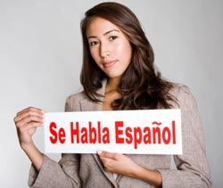 Spanish Speaker holding a Se Habla Espanol sign