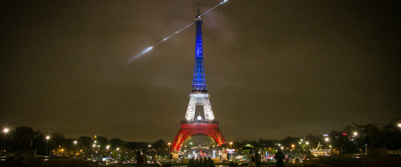 PARIS, FRANCE - NOVEMBER 24:  An artwork entitled 'Earth Crisis' by US artist Shepard Fairey is displayed on the Eiffel Tower illuminated in the colors of the french flag 'Blue-White-Red', as part of the organisation of the Conference on Climate Change COP21 on November 24 in Paris, France. The climate change conference COP21 will gather 193 countries in Paris from November 30 to December 11, 2015.  (Photo by Marc Piasecki/Getty Images)